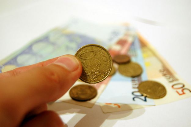 Hand holding a coin from 4freephotos.com